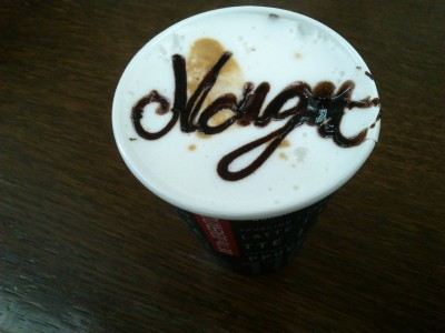 Nougat written on my beverage with chocolate syrup